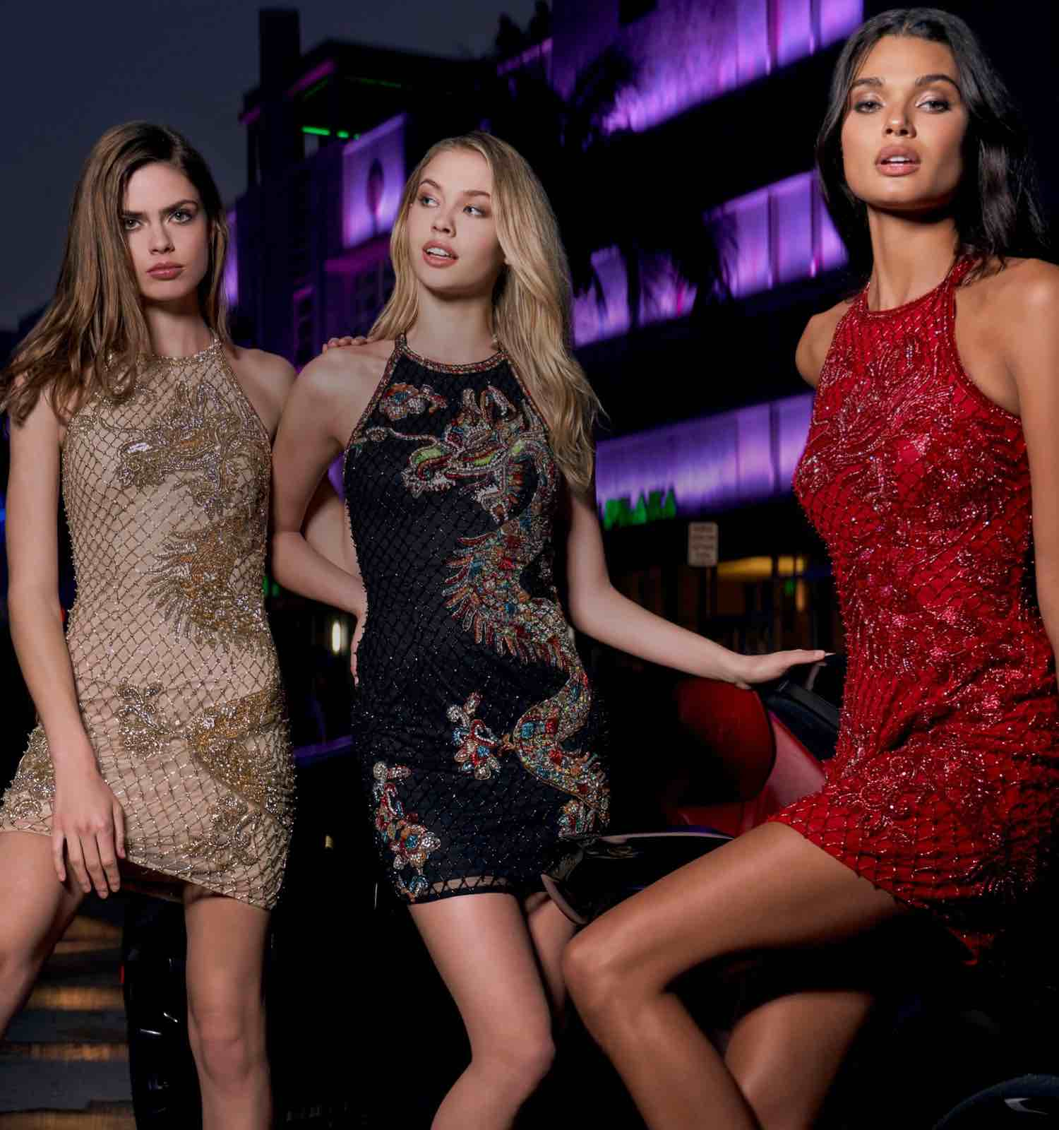 Three models wearing short Sherri Hill homecoming dresses