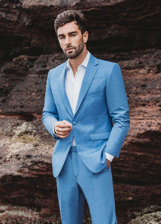 Model wearing a blue tuxedo